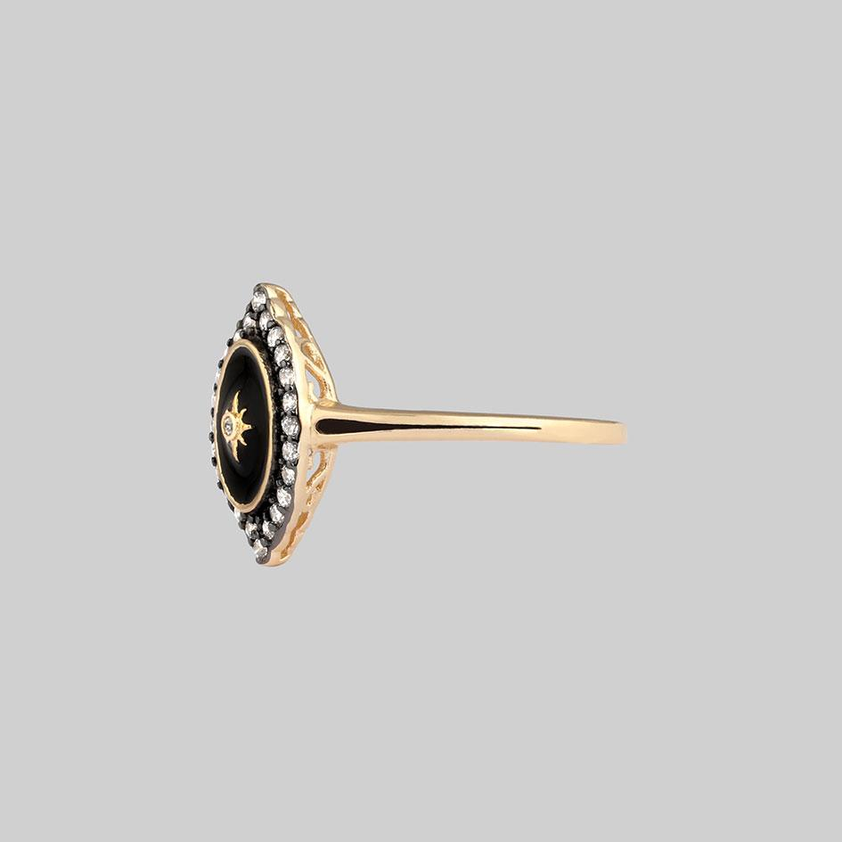 gold ring with crystals and black frame