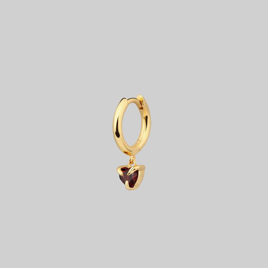 gold hoop earring with garnet heart