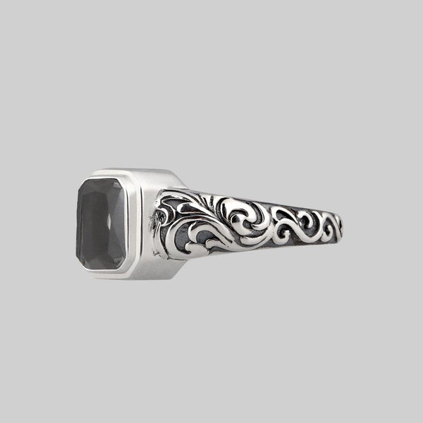 silver urn ring with transparent glass