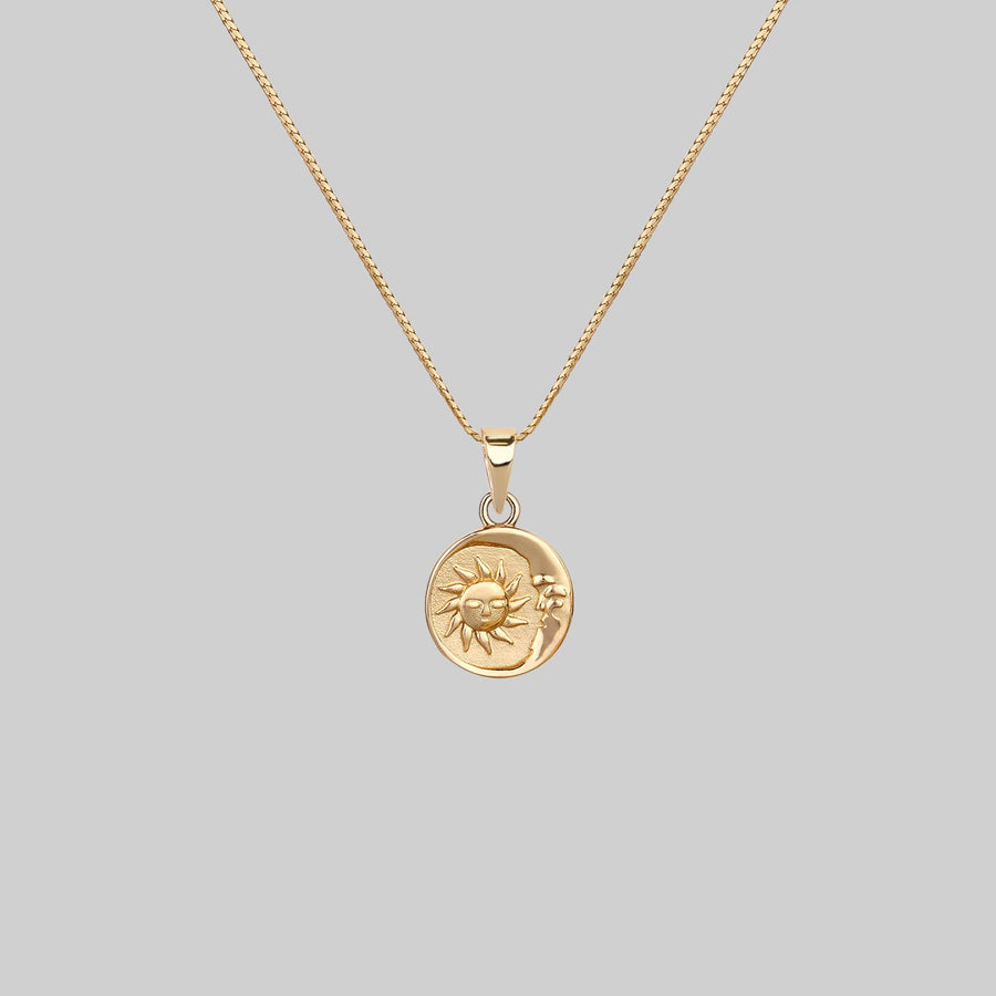 sun and moon medallion necklace gold