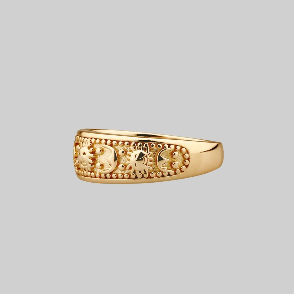 thick gold band ring with sun and moon