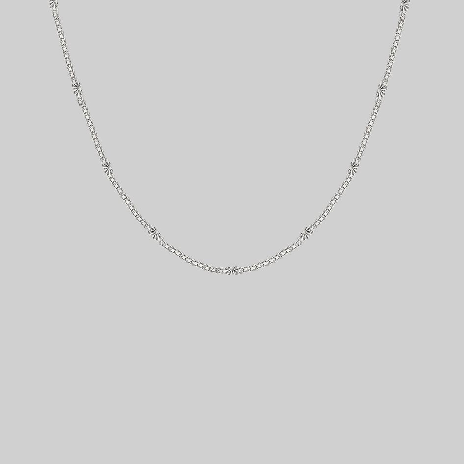 layering sunburst chain necklace gold