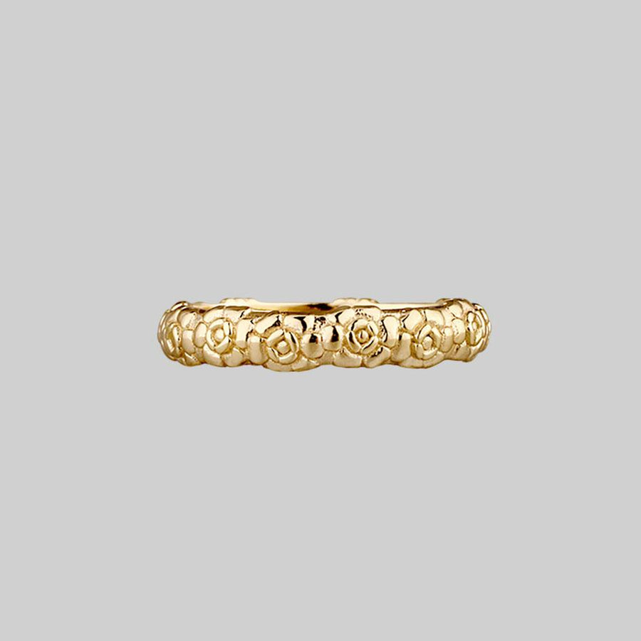 Floral gold posey ring with words inside