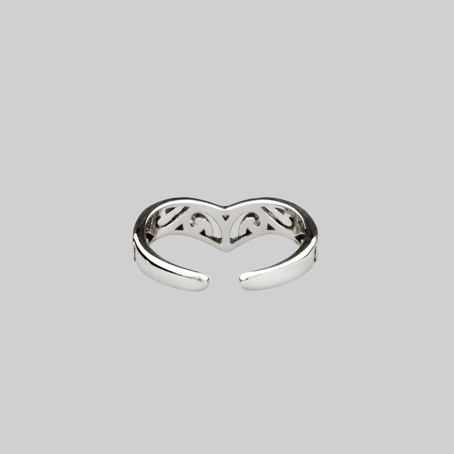 adjustable toe ring with swirl pattern