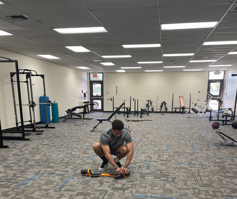 middle school teacher setting up MAXPRO in his weight room