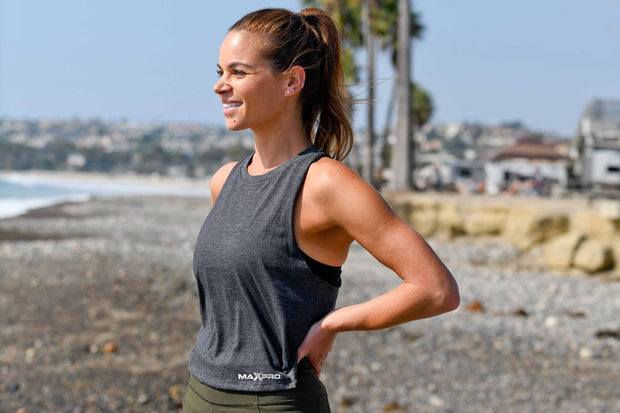 Introducing the crop you've been waiting for. This women's racerback cropped tank top features a relaxed fit and comes in our heather fabrication. The modern, elongated armholes and the racerback with raw edge details make this tank a must-have.
