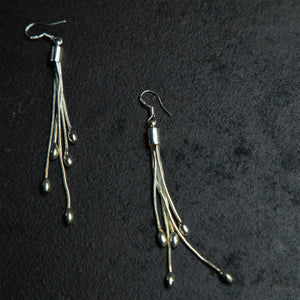 Rebel Hearts Modern Earrings having Silver toned colors. These beauties are called the Simple tassel drop