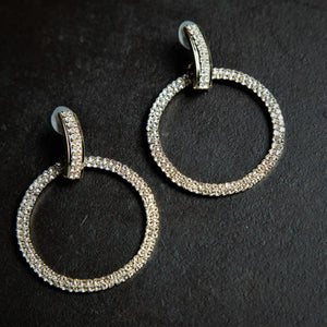 Rebel Hearts Modern Earrings having White, Gold colors. These beauties are called the Rings of Charm