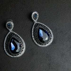 Rebel Hearts Modern Earrings having Blue, silver toned colors. These beauties are called the Heart of the Ocean