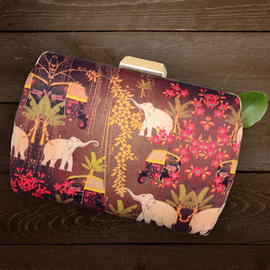 Haathi Aur Auto, Fabric Printed Clutches;  This Fabric Rounded Box clutch is made up of Polyester silk with Sling Chain included and fabric on both sides. It has a smooth, soft finish with sturdy metal Frame. It easily accomodates all smart phones and is comfortable to carry with sling chain included in the package.