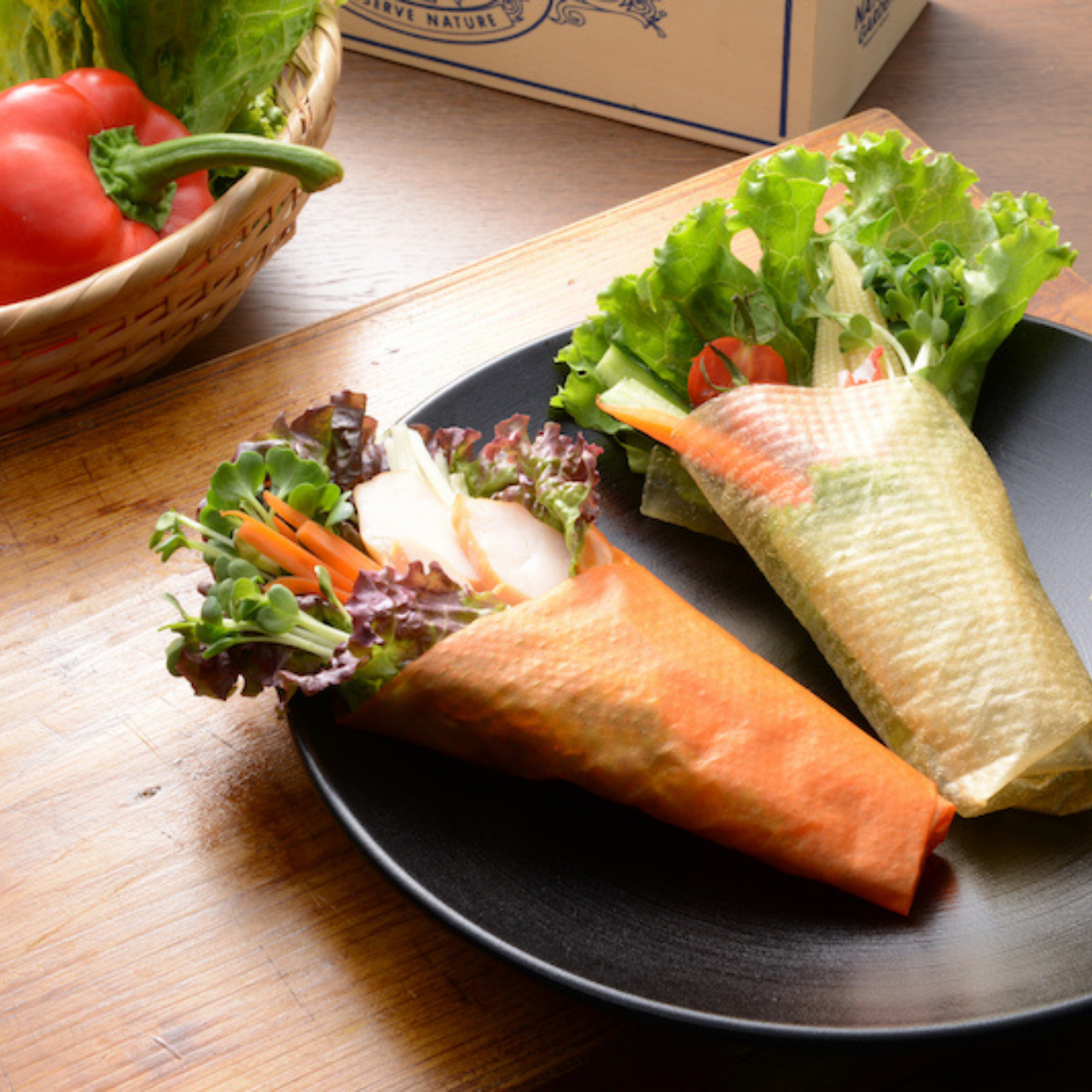 A plate of two vegetable wraps next to paprika