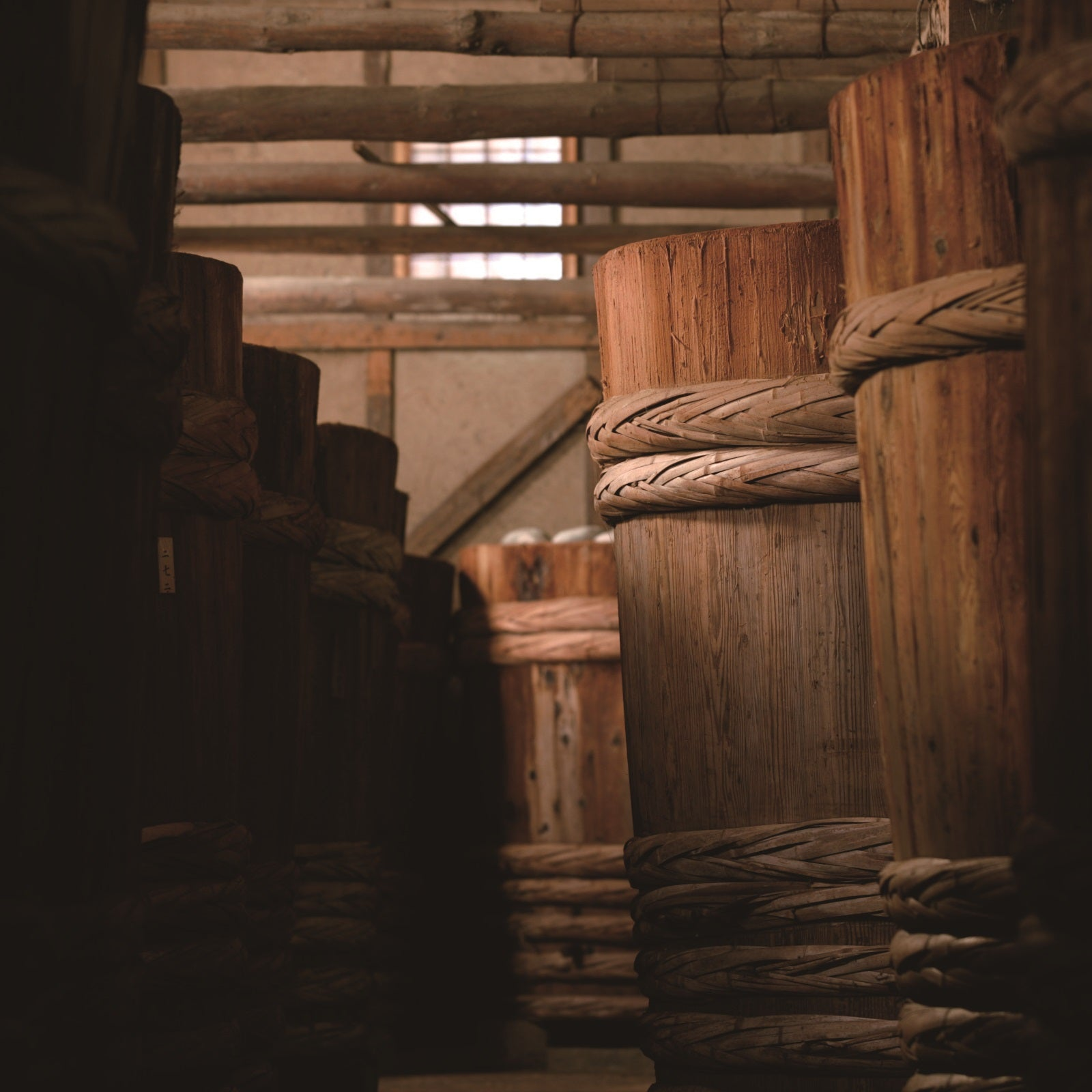 Wooden barrels stored in factory