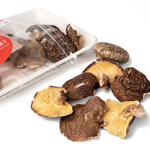 Dried shiitake Koshin mushrooms popping out of package