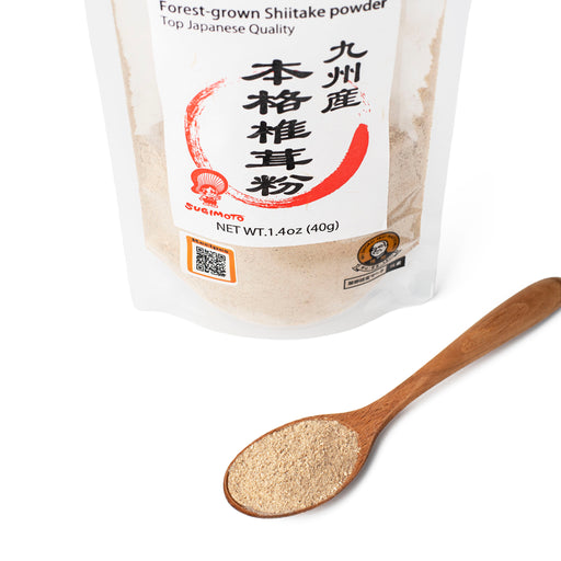 A spoon of shiitake mushroom powder next to package of the product