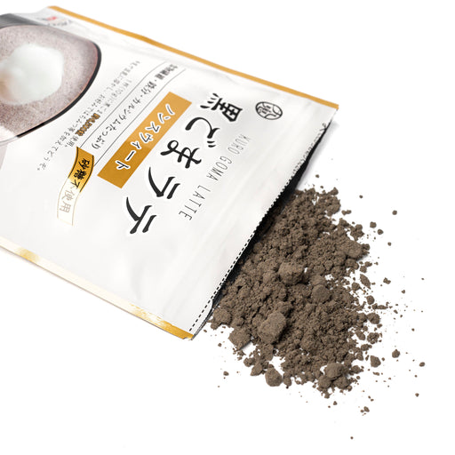Black sesame latte mix popping from package