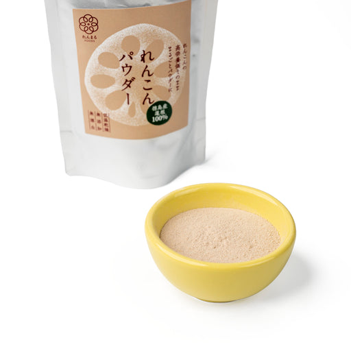 A small bowl of Japanese lotus root powder next to package bag of the product