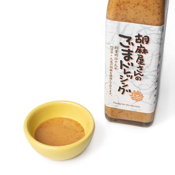 A small bowl of sesame dressing next to bottle of the product