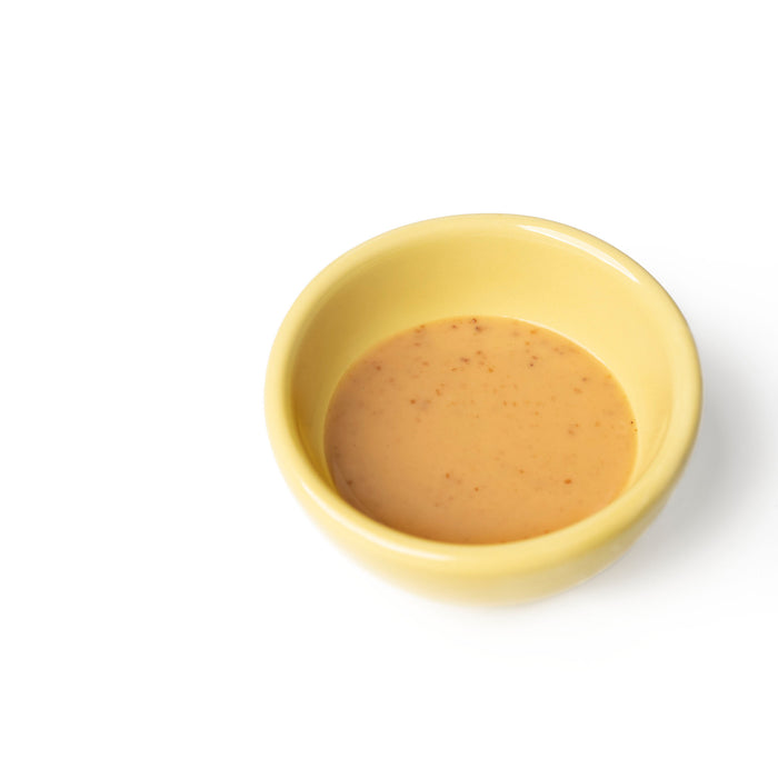 A small bowl of sesame dressing