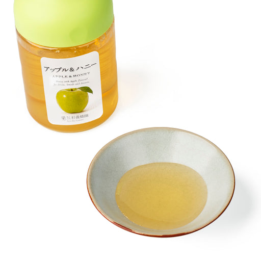 A small bowl of Apple Honey next to package bottle of the product