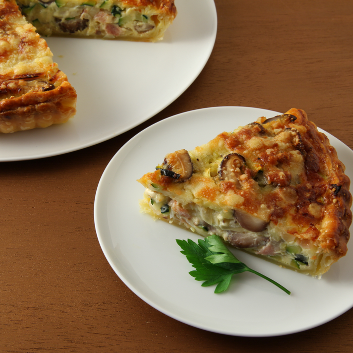 A plate of a slice of quiche