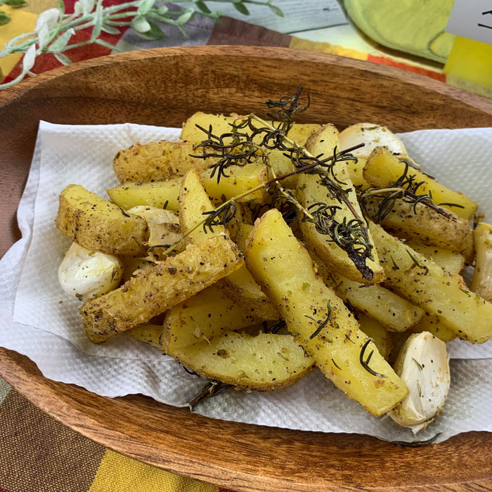 A bowl of french fries with shiitake mushroom powder