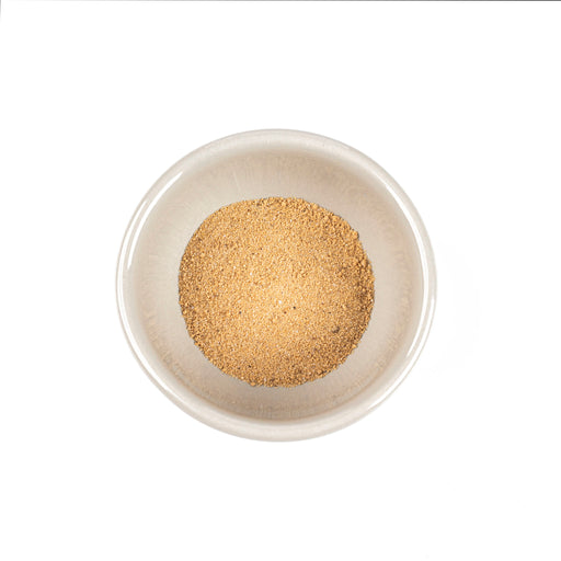 Overhead shot of a small bowl of dashi powder