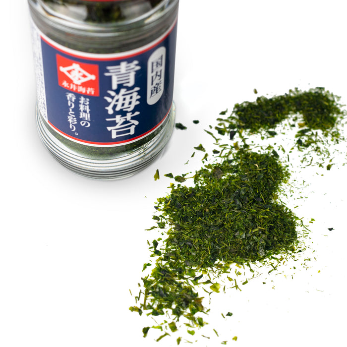 Scattered nori seaweed flakes next to a bottle of the product