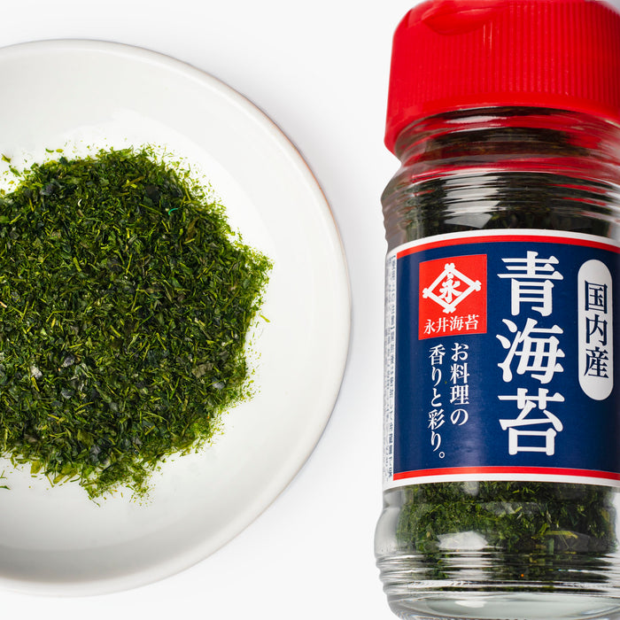 Overhead shot of a small bowl of nori seaweed flakes and a bottle of the product