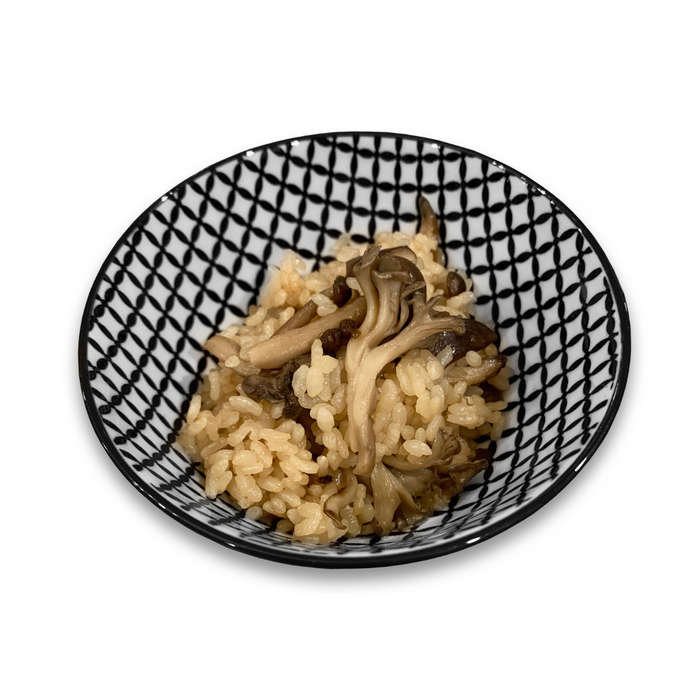 A ceramic bowl of rice with maitake mushrooms