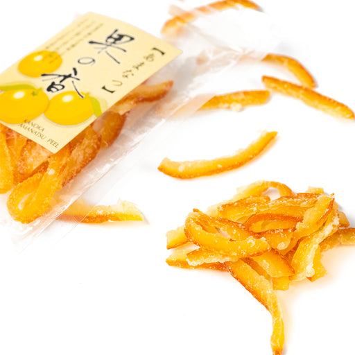 Scattered candied amanatsu peel out of package