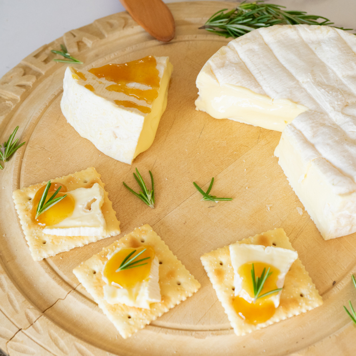 Cheese and crackers topped with organic yuzu spread