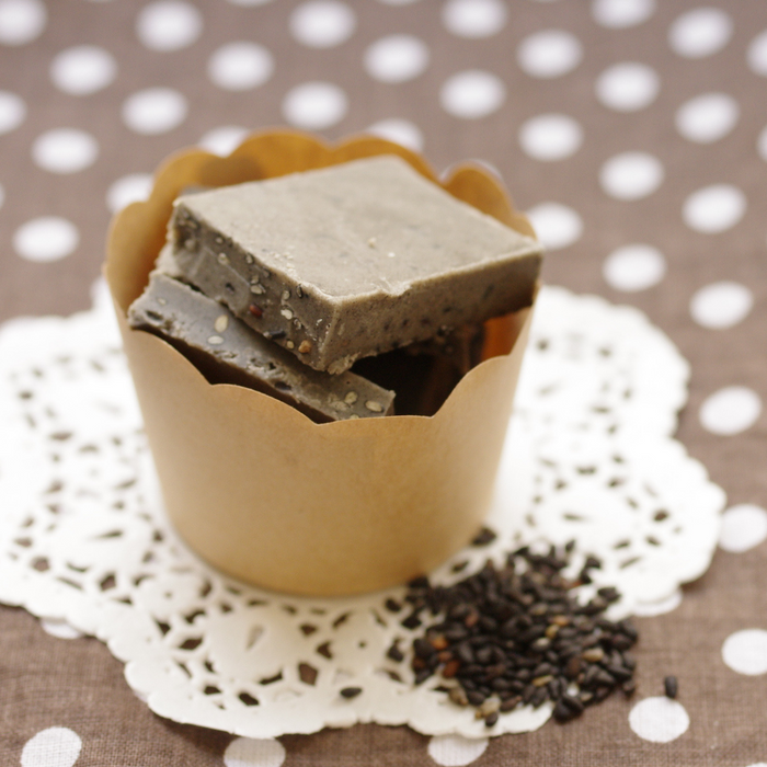 A paper cup of black sesame chocolate bars