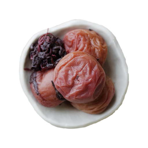 Overhead angle of four pieces organic umeboshi  on small bowl