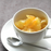 A cup of fresh grape fruits topped with organic yuzu spread