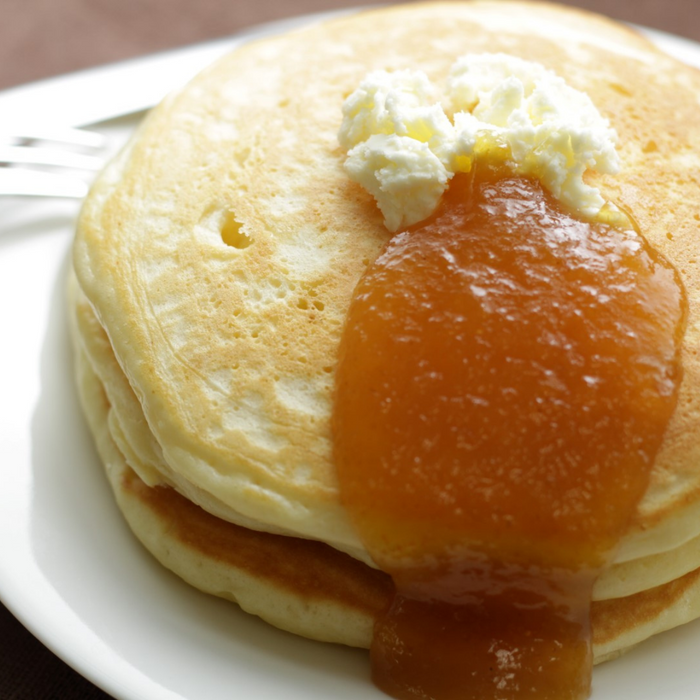 Pancakes topped with butter and organic yuzu spread