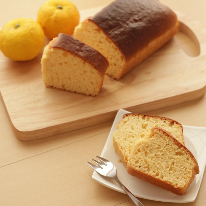 A plate of two slices of yuzu cake