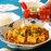 Mapo tofu being drizzled with rayu from bottle of the product