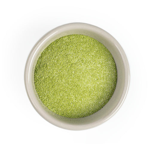 Overhead shot of small bowl of matcha pudding mix