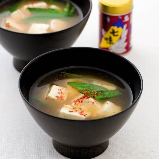 Two bowls of miso soup topped with shichimi tograshi pepper powder