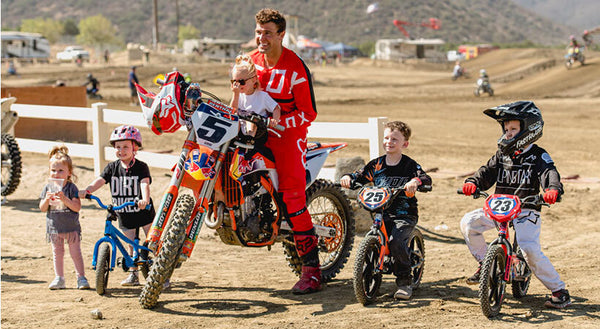 Ryan Dungey with a group of children