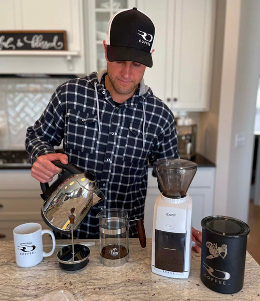 Ryan brewing some RD Coffee in a French Press