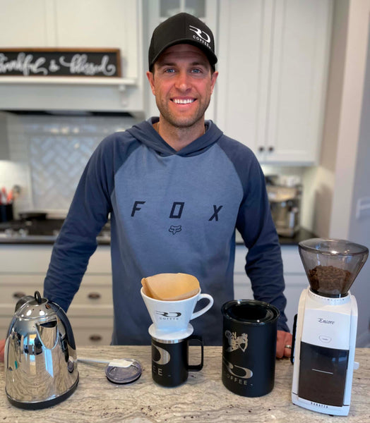 Ryan Dungey happily posing with supplies needed to prepare pour-over coffee