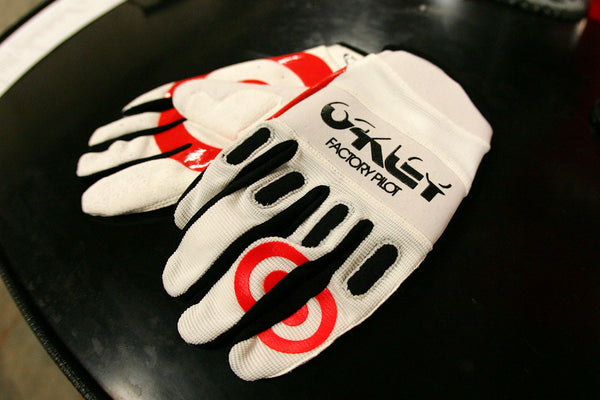Ryan Dungey gloves that features both Target and Oakley logos