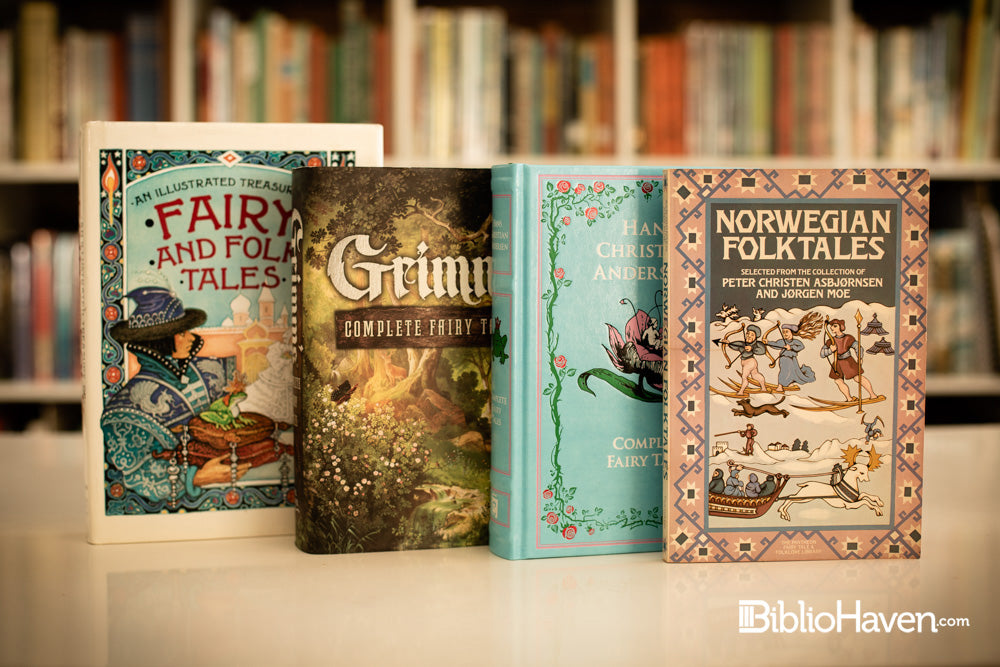 Four Folk and fairy tales books shown in front of hundreds of books on a shelf blurred in the background.