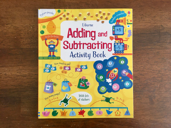 Usborne Adding and Subtracting Activity Book, Like New