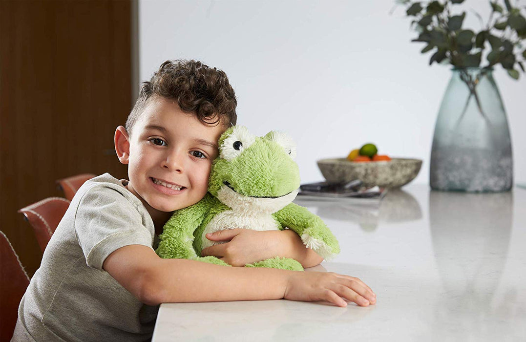 boy holding warmies frog heatable toy