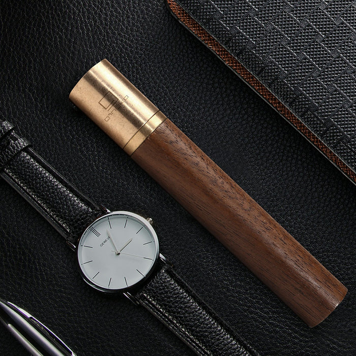 gingko natural wood flameless lighter in american walnut pictured next to a watch with a black leather strap