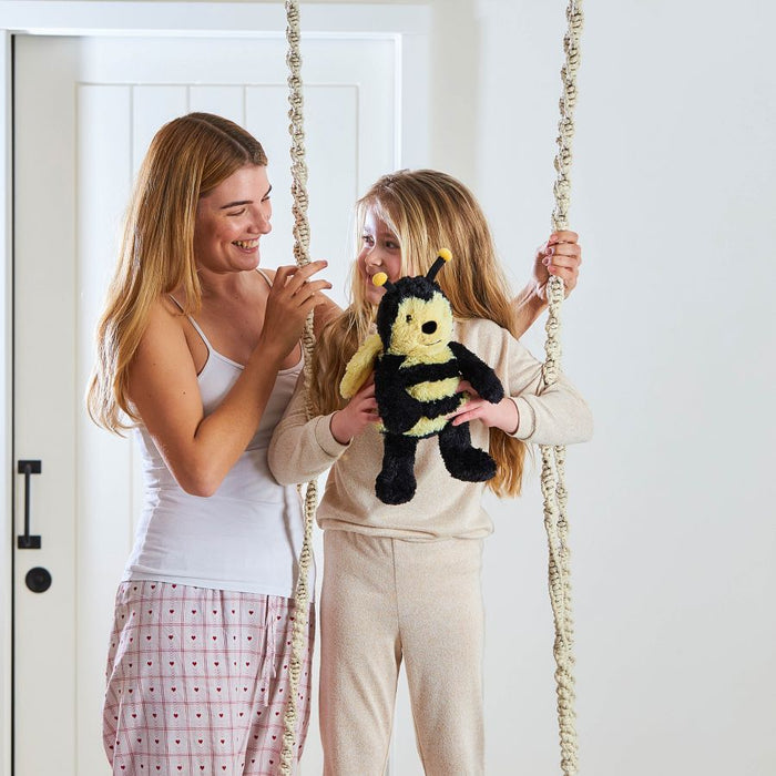 Mother and Daughter Holding Bee Toy