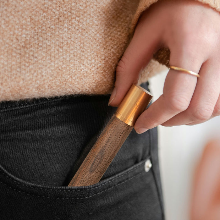 woman picking up a gingko flameless lighter out of her pocket