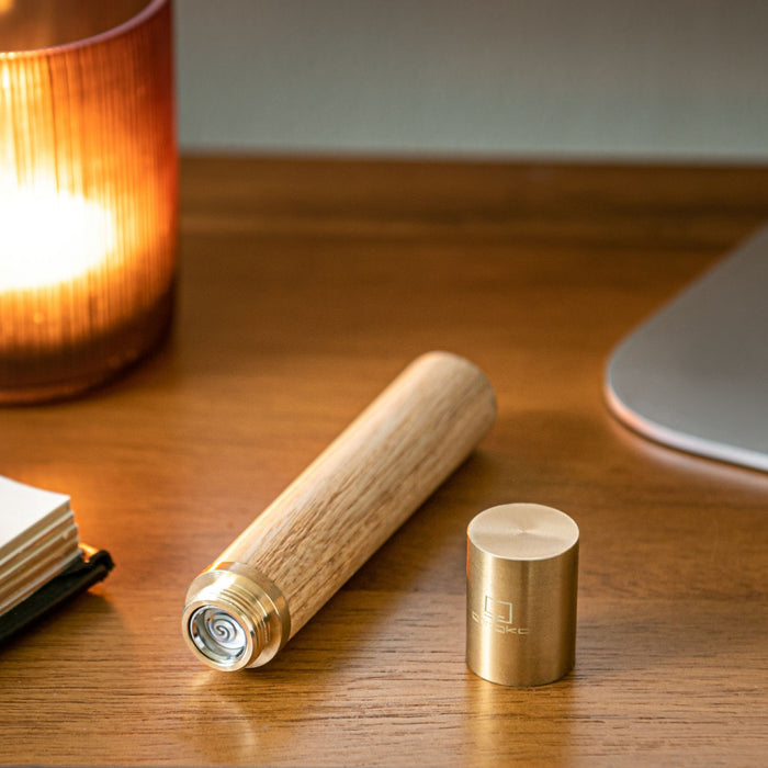 gingko natural wood flameless lighter in white ash lay horizontally with the lid off